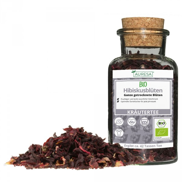 Loose organic hibiscus blossom tea in a glass