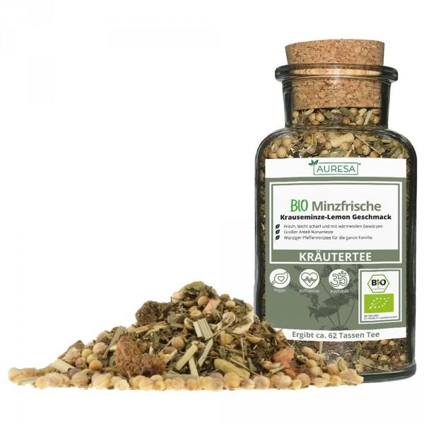 Loose organic Minzfrische herbal tea in a glass