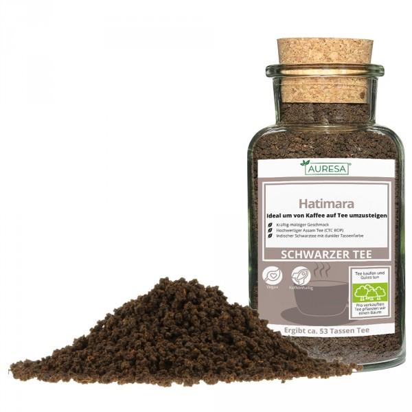 Loose black tea from Assam Hatimara in a glass